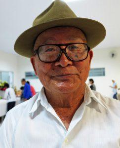 トレードマークのおしゃれな帽子をかぶった高橋隆さん